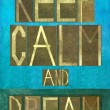 "Earthy background image and design element depicting the words ""Keep calm and dream"" — Stock Photo"