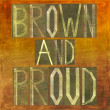 "Earthy background image and design element depicting the words ""Brown and proud"" - Stock Photo"