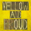 Earthy background image and design element depicting the words Yellow and proud — Stock Photo