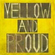 Earthy background image and design element depicting the words Yellow and proud — Stockfoto