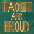 "Earthy background image and design element depicting the words ""Taoist and proud"" - Stock Photo"