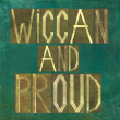 "Earthy background image and design element depicting the words ""Wiccan and proud"" - Stock Photo"