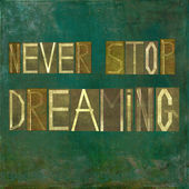 "Earthy background image and design element depicting the words ""Never stop dreaming"" — Stock Photo"