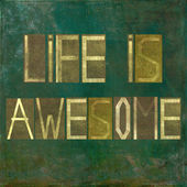 "Earthy background and design element depicting the words ""Life is awesome"" — Stock Photo"
