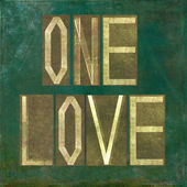 "Earthy background image and design element depicting the words ""One love"" — Stock Photo"