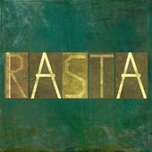 "Earthy background image and design element depicting the word ""Rasta"" — Stock Photo"