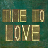 Earthy background image and design element depicting the words about love — Stock Photo