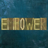 """Earthy background and design element depicting the word """"Empower"""" — Stock Photo"""