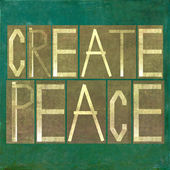 "Earthy background and design element depicting the words ""create peace"" — Stock Photo"