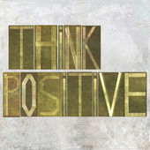 "Earthy background image and design element depicting the words ""Think positive"" — Stock Photo"