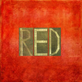 "Earthy background image and useful design element depicting the word and colour ""red"" — Stock Photo"