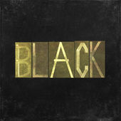 "Earthy background image and useful design element depicting the word and colour ""black"" — Stock Photo"