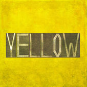 "Earthy background image and useful design element depicting the word and colour ""yellow"" — Stock Photo"