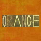 "Earthy background image and useful design element depicting the word and colour ""orange"" — Stock Photo"
