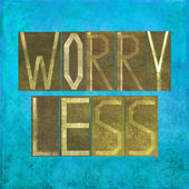 "Earthy background image and design element depicting the word ""worry less"" — Stock Photo"