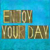 """Earthy background and design element depicting the words """"Enjoy your day"""" — Stock Photo"""