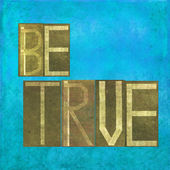 """Earthy background image and design element depicting the words """"Be true"""" — Stock Photo"""