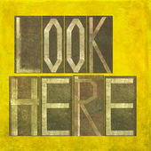"Earthy background image and design element depicting the words ""Look here"" — Stock Photo"