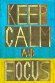 """Earthy background image and design element depicting the words """"Keep calm and focus"""" — Stock Photo"""
