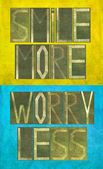 "Earthy background image and design element depicting the words ""Smile more, worry less"" — Foto Stock"