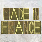 "Earthy background image and design element depicting the words ""Made in France"" — Stock Photo"