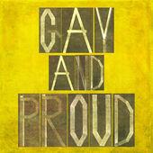 """Zemité pozadí obraz a design prvek zobrazující slova """"gay a hrdý"""" — Stock fotografie"""