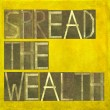 "Words ""Spread the wealth"" — Stock Photo"