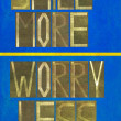 "Words ""Smile more Worry less"" — Stock Photo"