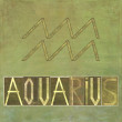 "Word and symbol for the zodiac sign ""Aquarius"" — Stock Photo"