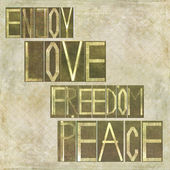 "Words ""Enjoy Love Freedom Peace"" — Stock Photo"