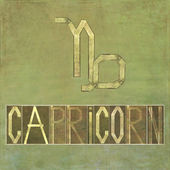 "Word and symbol for the zodiac sign ""Capricorn"" — Stock Photo"