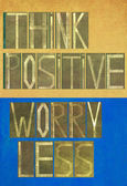 "Words ""Think positive Worry less"" — Stock Photo"