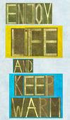 """λέξεις «απολαμβάνουν τη ζωή και το διατηρούμε ζεστό"""" — Φωτογραφία Αρχείου"""