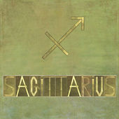 "Word and symbol for the zodiac sign ""Sagittarius"" — Stock Photo"