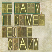 "Design element depicting the words ""Be happy, it drives people crazy"" — Stock Photo"