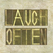 "Design element depicting the words ""Laugh often"" — Stock Photo"