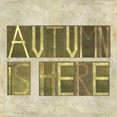 "Design element depicting the words ""Autumn is here"" — Stock Photo"