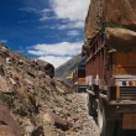 Trucks on mountain road — Stock Photo #13252770