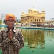Young pilgrim in Golden temple - Stock Photo