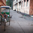 Rikshaw driver resting — Stock Photo