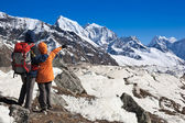 Trekkers in Himalayas — Stock Photo