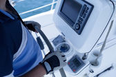 Captain at the helm of a sailboat — Stock Photo