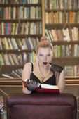 Reading in lingerie — Stock Photo