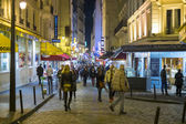 Paris, FRANCE - OCTOBER 19: Night shot of busy Rue de la Huchett — Stock Photo