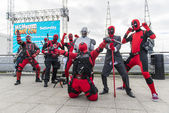 LONDON, UK - OCTOBER 26: Cosplayers dressed as Deadpool from the — Stock Photo