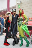 Cosplayers dressed as a  Harley Quinn, Catwoman and Poison Ivy — Stock Photo