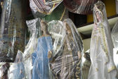 BELO HORIZONTE, BRAZIL - JULY 28: Religious icons wrapped in pla — Stock Photo