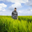 Man on a field — Stock Photo