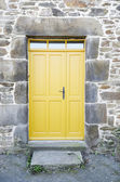 Yellow front door — Stockfoto