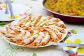 Shrimps and paella — Stock Photo